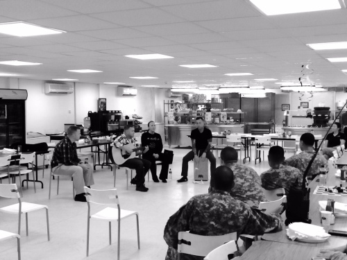 Performing for Soldiers in a small dining facility.